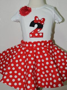 Great big number 2 decorated to look like Minnie Mouse and a red and white polka dot twirl skirt.  Perfect for your two year old's 2nd birthday party.  She will feel so special in her new Minnie Mouse set.  I can also personalize this for you at no additional cost.  I do not charge extra to personalize my shirt's or bodysuits.  Just add your child's name in the notes section on the order.  This can be made in short or long sleeves.   Shop this product here…