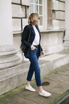 Emma Hill wears navy check blazer, white t-shirt, levis 501 jeans, Saint Laurent trainers, Chanel vintage bag, chic casual outfit