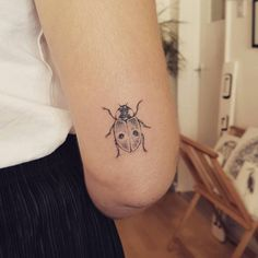 Handpoked two-spot ladybird tattoo for Jade.