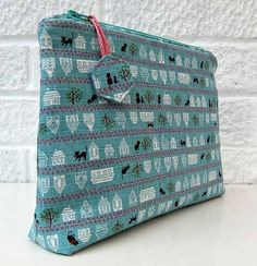 This large zippered pouch features a flat bottom which is not difficult to make and it helps the pouch stand up straight. Just the thing for holding bulky