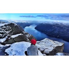 Stamp #550 - Norway: Winter Wonderland  View from Pulpit rock (Preikestolen) towards the spectacular Lysefjord. This is a natural rock formation with a 25 meter squared plateau that stands 604 meters above the sea. The hike takes around 3-4 hours. Thanks @siripiriliri for sharing your #stamp! For more adventures and travel tips download the Stamp Travel App today. The link is in our bio!