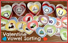 16 Free short vowel pics printed on hearts for a sweet seasonal small group instruction activity.