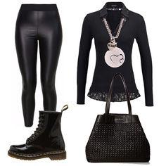 Il nero il colore predominante in questo outfit, trasgressivo ed elegante allo stesso tempo, indossiamolo di sera o nel tempo libero. Maglione noir con scollo a v, leggings neri di pelle, stivaletti neri in vernice lucida, borsa a mano nera.
