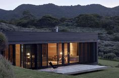 Fearon Hay Architects designed the Storm Cottage project located in Great Barrier Island. Completed in this contemporary cottage home is a retreat that Architecture Durable, Sustainable Architecture, Architecture Design, Building Architecture, Container Home Designs, Tiny House Movement, Black Exterior, House And Home Magazine, House Design