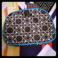 """NWT ELLE geometric pattern cosmetic bag! ELLE geometric print cosmetic bag! Black with white geometric design and turquoise trim! Has a handle and 2 zipper closures! """"Plenty of storage for all of your beauty products and tools!"""" """"Elastic loops perfect for travel bottles and extra storage!"""" NWT! Fast shipper! BUNDLE to save 30%! Elle Bags Cosmetic Bags & Cases"""