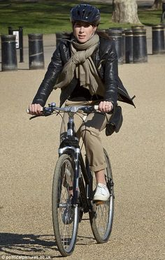 The Prime Minister's wife may have been feeling the heat as she pedalled along as leather probably isn't the best choice for sunny day in London. Samantha teamed her ...