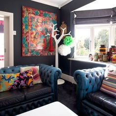 Dark walls with contrasting soft furnishings