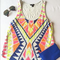 Neon Tribal Print Tank Top! This tank top is bright and fun! Pair it with some cutoff shorts and some sunnies! Item is measured relaxed when laid on a flat surface. Length: 22.5in                                                         Bust: 17.5in Express Tops Tank Tops