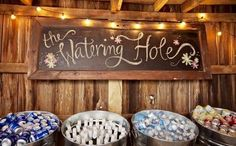 A 'watering hole' blackboard sign for where the drinks are? It looks cute ;-)
