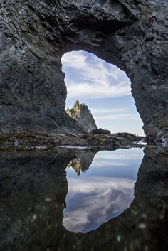 Hole in the Wall, a popular destination at   Olympic National Park's Rialto Beach (above), is   reflected in a tide pool.