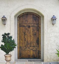 I have an obsession with beautiful doors...love the antique look of this one!