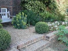 A corner of a garden I designed in Wimbledon some years ago. From the little garden seat you look down onto an Herb Garden Garden Seating, Wimbledon, Herb Garden, The Great Outdoors, Garden Design, My Design, Corner, Gardens, Herbs