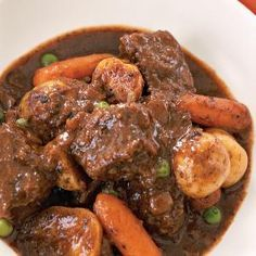 Classic Beef Stew - 4 lbs. bottom round - flour - olive oil - 2 large onions - tomato paste - dry red wine - potatoes - baby carrots - beef broth - kosher salt - dried thyme - bay leaf - frozen peas