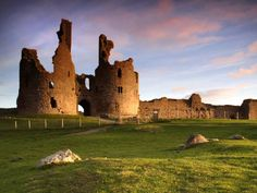 England - The ruins of Dunstanburgh Castle, not far from Scottish borders, tower over the Northumberland coastal line. The Castle was built on magnificent scale, and rivaled any castle of its day.