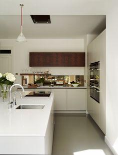 Roundhouse Urbo matt lacquer bespoke kitchen with mirror splashback