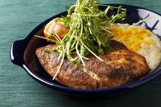 Blackened Tilapia with Cheddar Grits & Pea Shoots. Visit http://www.blueapron.com/ to receive the ingredients.