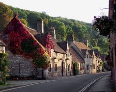 Quaint shops and cottages line a street in the small village of Castle Combe in England. English Village, English Cottages, Castle Combe, English Countryside, London England, England Uk, British Isles, Great Britain, Beautiful Places