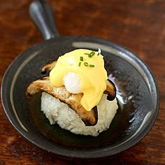 Eggs Benedict with a twist: made with a rice ball, shiitake mushrooms, poached quail egg, and lime hollandaise
