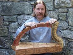 Simon Chadwick with replica of 15th century Queen Mary harp (clarsach)