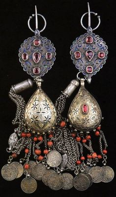Pair of Moroccan fibulae, consisting of silver, enamel, silver gilt, coral, old coins, and glass paste. Posted by Linda Pastorino.