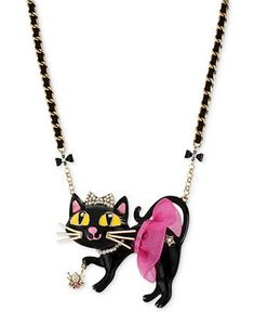 A pretty kitty from Betsey Johnson. This tutu cat pendant boasts a sparkling spider accent and is beautifully crafted in antique gold-tone mixed metal with glass crystals, plastic accents and a grosgrain ribbon detail. Approximate length: 16 inches + 3-inch extender. Approximate drop: 2-1/4 inches.