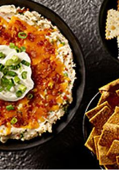 "Loaded ""Baked Potato"" Dip – Enjoy all the cheesy, bacon-studded deliciousness of a loaded baked potato—in a creamy appetizer dip. Bonus: Instant flakes trim down the prep time."