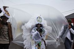 On Fat Tuesday, the Mardi Gras Indians come out of their respective neighborhoods and converge underneath the Claiborne overpass, the nexus of Mardi Gras for much of the black community. In a picture from 2013, Big Chief Victor Harris of Fi Yi Yi (also known as the Mandingo Warriors), walks down St. Bernard Avenue as the rain starts to fall. Two men stretched out plastic sheeting to protect his suit as the chief shouted one of his chants.