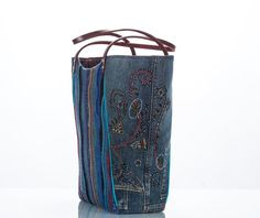 The Denim Collection of totes uses upcycled denim jeans and thrift-find sweaters. One of a kind.