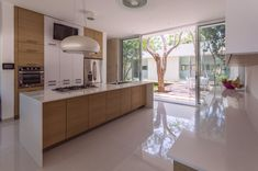 Modern kitchen in white and wood