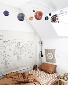 World and planet toddler room/ big boy room. I love the simplicity of this.