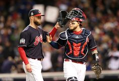 Cleveland Indians Corey Kluber taps catcher Roberto Perez after striking out the side in top of the 2nd inning, in game one of the World Series against Chicago, Tuesday, October 25, 2016.  Indians won 6-0 (Chuck Crow / The Plain Dealer)
