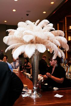 Roaring 20s birthday party ideas: Beautiful ostrich feather centerpiece