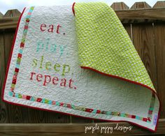 custom eat.play.sleep.repeat baby quilt (40x41) in your choice of colors. $195.00, via Etsy.