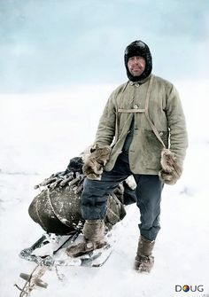 'Scott of the Antarctic'   Captain Robert Falcon Scott RN. 13th April 1911, (aged 43) standing by his sledge during preparations for the expedition the following year.