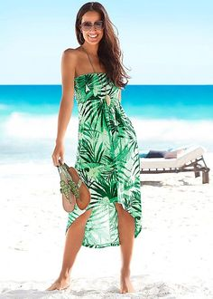 Elegant green beach dress in a gorgeous tropical print which has been designed with a fashionable dipped hem and a smocked insert. Note, each item is unique.Beachtime Dress Features: Colour: Green Print Washable Viscose Back length approx. 94 cm ins) Cute Casual Dresses, Casual Outfits, Cute Outfits, Beach Dresses, Summer Dresses, Beachwear For Women, Comfortable Fashion, Spring Summer Fashion, Ideias Fashion