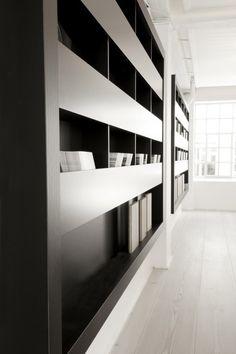 Cabinets in dark wood. The Dinesen showroom by Space Copenhagen.