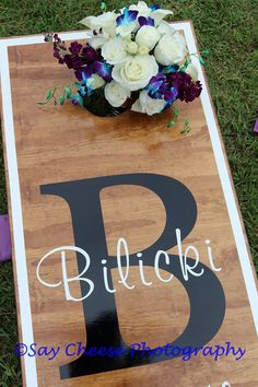 We love these custom cornhole boards for outdoor wedding games. Keep your wedding guests entertained during cocktail hour!