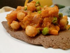The delicious, nutritious, & vegan Ethiopian Chickpea Wat dish will make your mouth water and clamour for more!