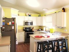 Kitchen using crown molding to redefine kitchen space!
