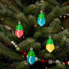 etsy shope full of Hama bead creations - great ideas such as Pixel Art Christmas Light Ornaments by adamcrockett Perler Bead Designs, Hama Beads Design, Perler Bead Art, Christmas Perler Beads, Xmas Ornaments, Fuse Bead Patterns, Beading Patterns, Bracelet Patterns, Stitch Patterns