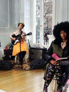 Julia Sarr-Jamois & Lianne La Havas at London Fashion Week's Moschino Cheap & Chic.  This is so fabulous, what is even happening? <3