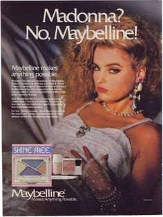 """Maybe it's Madonna? Nope, just a lookalike model in an ad capitalizing on the world's coolest star of the decade. """"For the 'Madonna look,' use all four colors from the new Fresh Violets Collection shading from darkest on the lids to lightest under brows,"""" the ad suggests."""