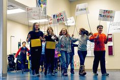 "Columbus Jewish Day School students celebrated the life of Martin Luther King Jr. with a Jan. 16 assembly into which the students marched while singing ""We Shall Overcome."""