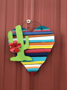 I created this unique wall Decour from corrugated tin and hand painted it to look like serape fabric. The heart measures 14 x 12 inches. A lime green cactus with red flower make this a really fun item. Diy Arts And Crafts, Crafts To Do, Diy Crafts, Barn Tin, Western Crafts, Cactus Decor, Pallet Creations, Corrugated Metal, Pallet Art