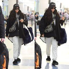 Rihanna Raf Simons denim jacket JFK airport, Bathory hat, Palace Skateboards grey hoodie and sweatpants, Fenty x Puma black fur slides and blue fur shopper tote, Dior oblique saddle bag