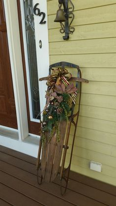 Making an entrance. this decorated vintage sled certainly ads curb appeal. Christmas Sled, Magical Christmas, Vintage Sled, Natural Materials, Accent Pieces, Curb Appeal, Ladder Decor, Entrance, Cabin