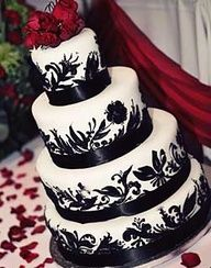 back and white cake with red rose accent