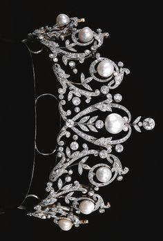 ATTRACTIVE  NATURAL  PEARL  AND  DIAMOND  NECKLACE/TIARA,  CIRCA  1900	 Designed  as  graduated  open  work  garlands  of  floral  and  foliate  motifs,  highlighted  with  seven  pearls  measuring  from  approximately  11.6  to  15.4  mm,  millegrain-set  with  rose,  cushion-shaped  and  circular-cut  diamonds