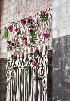 Chunky knots and flowers add a rustic natural element to an industrial urban space. Credit: hellomay.com.au #weddingdecor #macrame