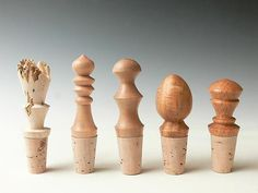 """""""Set of Five Wooden bottlestoppers"""" Created by Dewey Garrett One of a Kind Hand-turned wooden bottle stoppers in various woods. Sold in a set, as shown."""